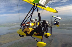 yellow trike an  wing over florida